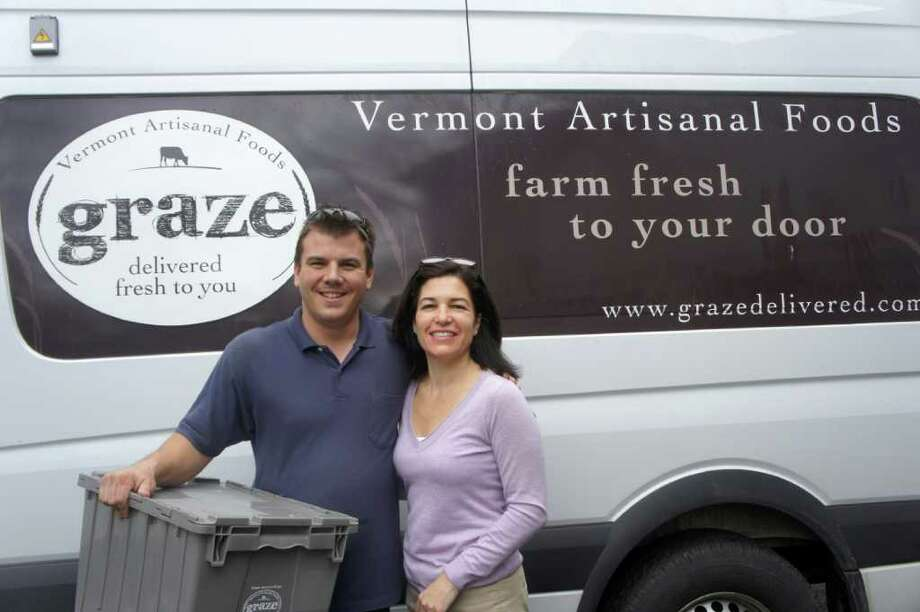 George Waterman,  a driver for Graze from Vergennes, Vt., and Christy Calusardo stand in front of a company delivery van. The firm, which was co-founded by Calusardo and Julianna Doherty, owner of  Barnum Hill Farm in Brisol, Vt., makes weelky deliverieis of Vermont's farm products to the doors of Fairfield County residents. Photo: Paul Schott/Westport News