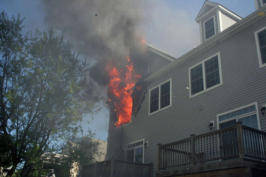 Fire officials are investigating a blaze that broke out Tuesday morning at 157 Brentwood Avenue. No one was home at the time and it appears the fire started on the third floor. Photo: Contributed Photo / Fairfield Citizen