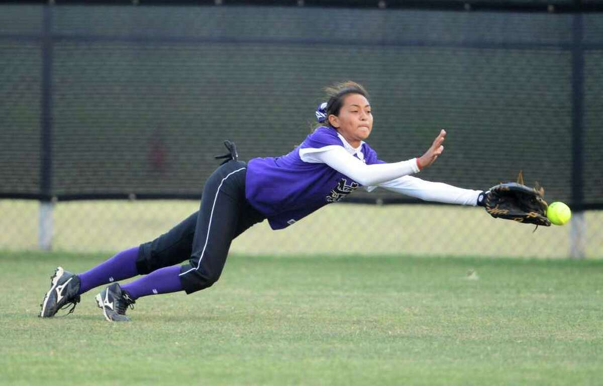 San Marcos outfielder Daniella Doria just misses making a diving catch during a Class 5A second-round softball playoff game between the O'Connor Panthers and the San Marcos Rattlers at Steele High School in Schertz, Texas on May 6, 2011 John Albright / Special to the Express-News.