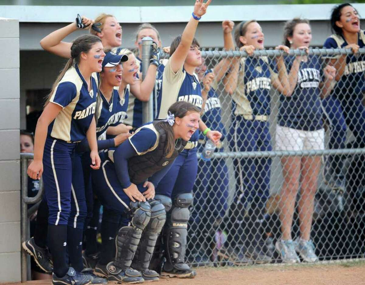 O'Connor Panthers softball team celebrates from the dugout during a Class 5A second-round softball playoff game between the O'Connor Panthers and the San Marcos Rattlers at Steele High School in Schertz, Texas on May 6, 2011 John Albright / Special to the Express-News.