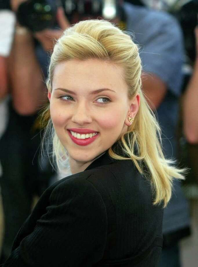 American actress Scarlett Johansson poses for photographers during a photo call at the 58th international Cannes film festival on May 12, 2005. (AP Photo/Lionel Cironneau, File) Photo: LIONEL CIRONNEAU / AP