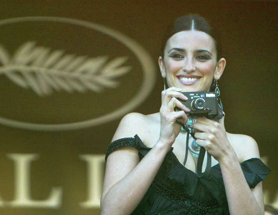 "Spanish actess Penelope Cruz takes a snap spot as she arrives for the screening of her film ""Fanfan La Tulipe,"" out of competition, directed by French Gerard Krawczyk at the opening of the 56th Film Festival in Cannes, France, Wednesday, May 14, 2003. (AP Photo/Michel Euler) Photo: MICHEL EULER / AP"