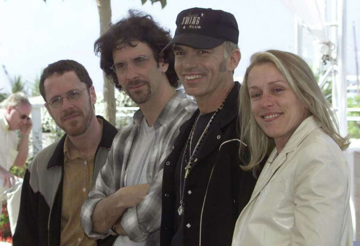 FILE - American director Joel Coen, second from left, poses with his brother Ethan, left, his wife American actress Frances McDormand and actor Billy Bob Thornton, second from right, during a photo session for their film ''The Man Who Wasn't There,' which opened in competition at the 54th International Film Festival in Cannes, southern France, Sunday, May 13, 2001.