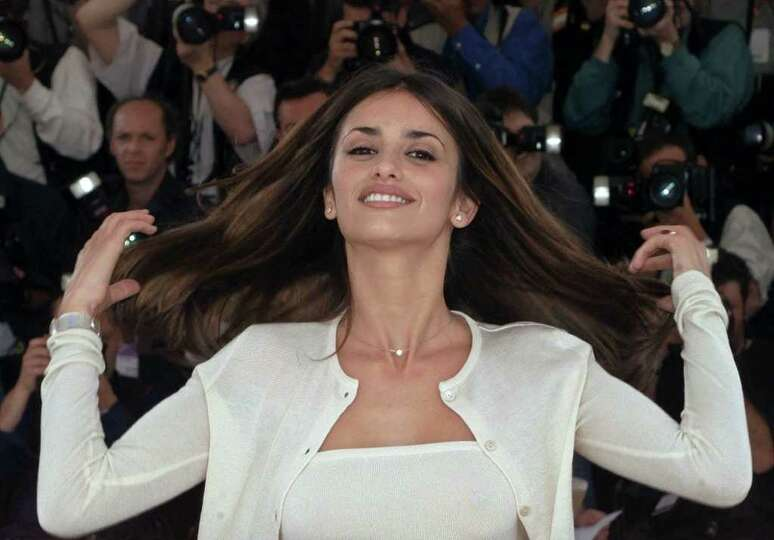 Spanish actress Penelope Cruz, gestures during a photocall for the film 'Woman On Top,' in competiti