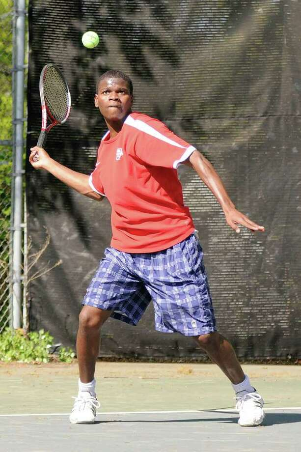McMahon's Dreshawn Lewis returns a volley in a boys varsity tennis match as Brien McMahon High School hosts Fairfield Ludlowe High School in Norwalk, CT on Monday May 9, 2011. Photo: Shelley Cryan / Shelley Cryan freelance; Norwalk Citizen freelance