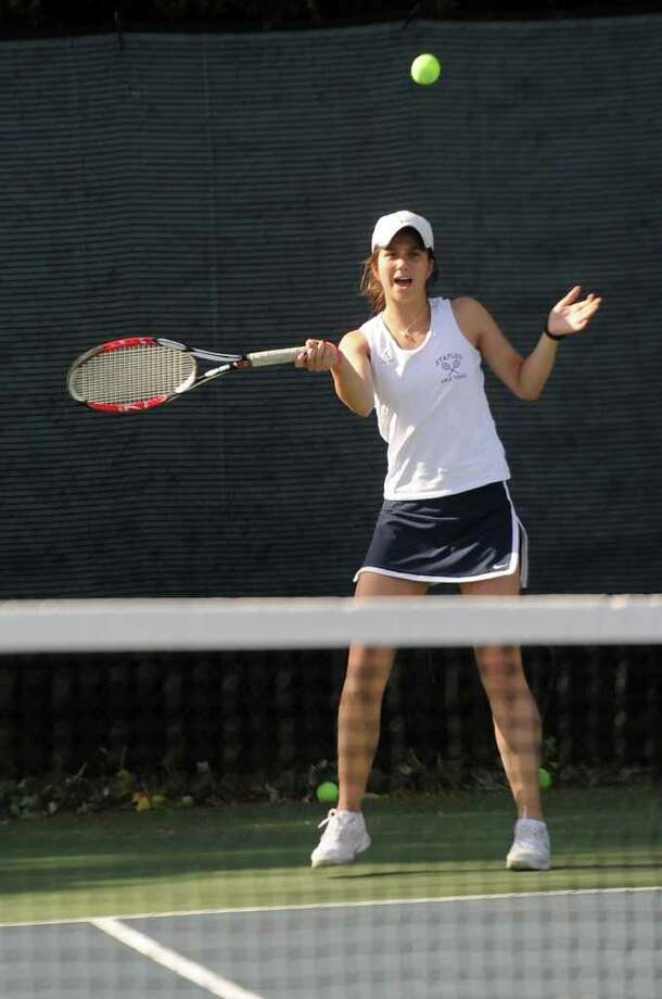 Melissa Beretta competes during Thursday's tennis match against Darien at Staples High School on May 5, 2011. Photo: Lindsay Niegelberg / Connecticut Post