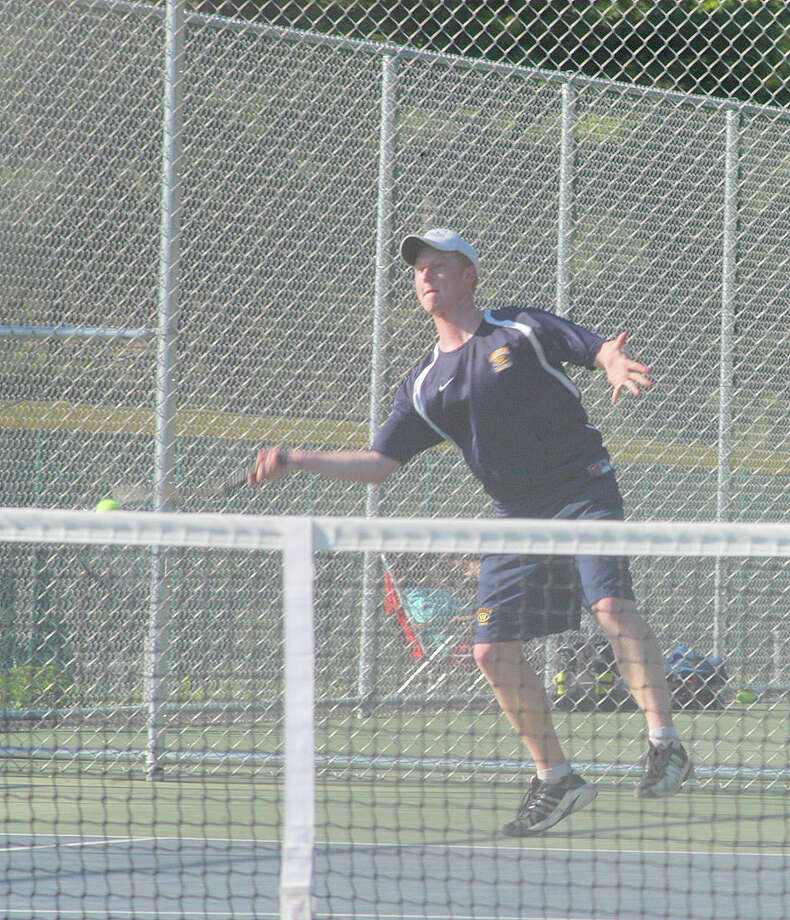Weston junior Cameron Hagen lost 6-4, 7-6 (7-5) at first singles Monday in a 5-2 Trojan victory at Newtown. Photo: Andy Hutchison For The Westport News