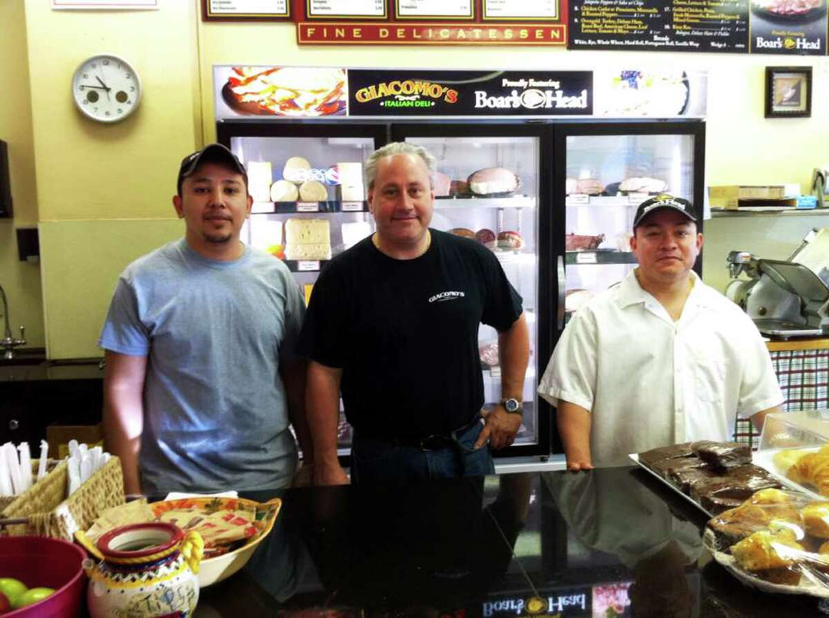 Jack Delli Carpini, owner of Giacomo's Deli at 1100 Hope St. in Stamford, Conn, is flanked by employees Joel Cruz and Santos Sierra. They are preparing for the opening of Giacomo's Springdale Market next door in early June.