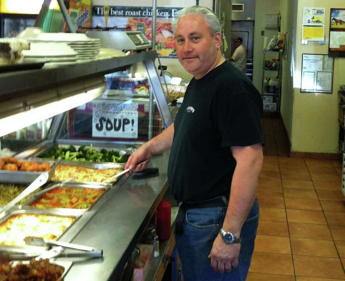 Jack Delli Carpini, owner of Giacomo's Deli at 1100 Hope St.,in Stamford, Conn. is preparing for the opening of Giacomo's Springdale Market next door in early June.