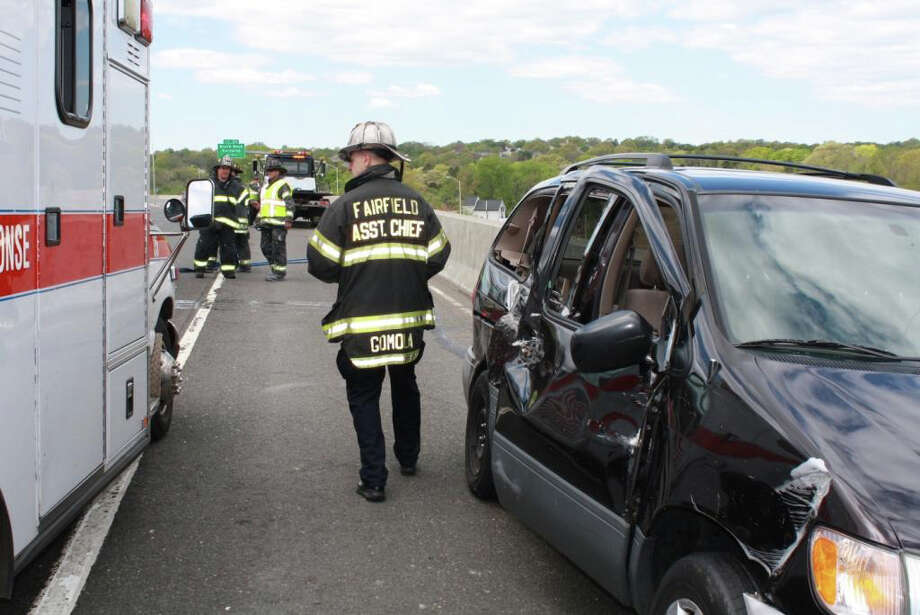 Firfighters inspect scene of crash between a cement mixer and a minivan Tuesday afternoon on Interstate 95 in Fairfield. Photo: Contributed Photo/Fairfield Fire Department / Fairfield Citizen contributed
