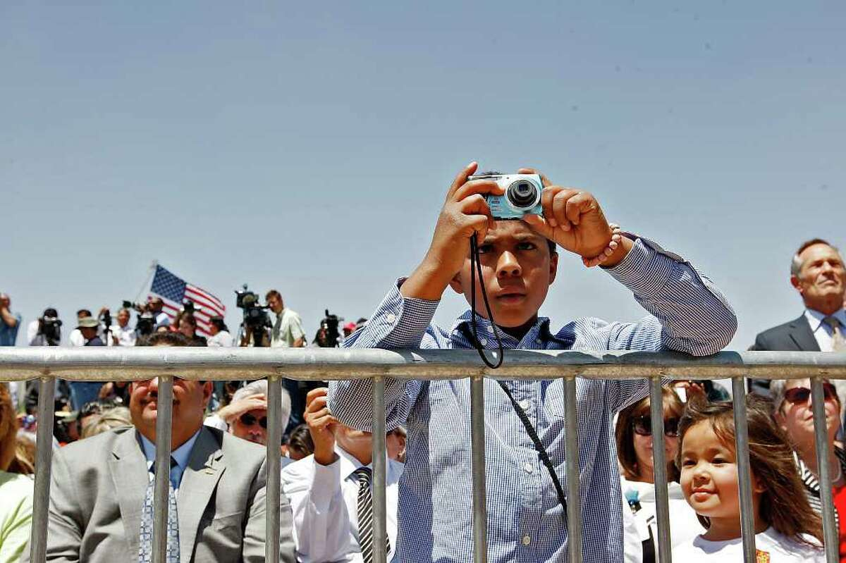 Tryston Obevoen documents as U.S. President Barack Obama delivers a speech on immigration reform before a crowd of 1500 at Chamizal National Memorial in El Paso, Texas, Tuesday, May 10, 2011.