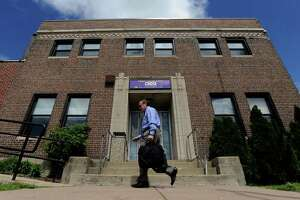 Richard Cavallaro, president of the Connecticut Federation of School Administrators, arrives at a meeting with other State Employees Bargaining Agent Coalition (SEBAC) members at a union office in Hartford, Conn., Tuesday, May 10, 2011.  Gov. Dannel P. Malloy said his administration is beginning the process Tuesday of issuing 4,742 layoff notices to Connecticut state employees because a two-year, $2 billion labor savings deal has not yet been reached with unionized workers.  SEBAC represents 15 state employee unions with around 45,000 state workers. (AP Photo/Jessica Hill)