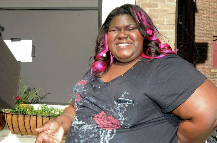 """Actress Gabourey Sidibe, best know for her role in the movie """"Precious,"""" stands outside Sundown Saloon on Greenwich Avenue. Sidibe was filming an episode of the Showtime series """"The Big C"""" at the bar on Tuesday, May 10, 2011. Photo: Helen Neafsey / Greenwich Time"""