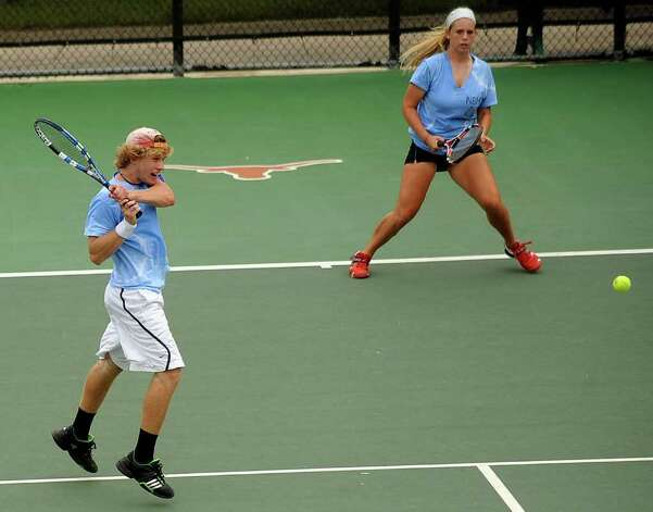 Beau and Liza Fieldsend of New Braunfels battle against Houston Memorial in mixed doubles during the UIL state tennis finals in Austin on Tuesday, May 10, 2011. They lost 7-4, 4-6, 7-6 (6). Photo: Billy Calzada/Express-News