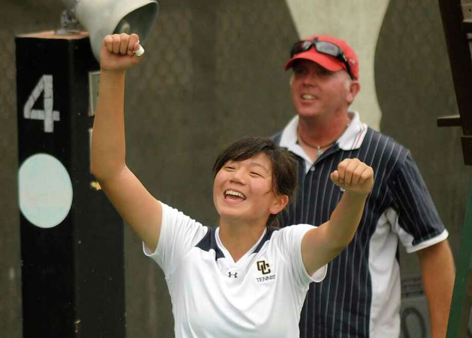 Mariana Rong of O'Connor High School is jubilant after winning the Class 5A girls singles tennis championship during the UIL state tennis finals in Austin on Tuesday, May 10, 2011. Photo: Billy Calzada/Express-News