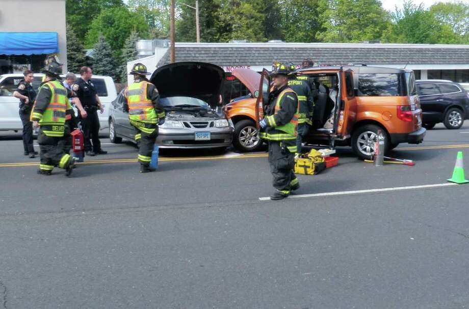 Two vehicles collided on Post Road East Tuesday afternoon, tying up traffic near Super Stop & Shop and sending one of the drivers to the hospital. Photo: Contributed Photo/Westport Fire Department / Westport News contributed