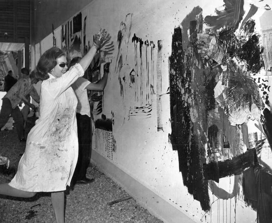 "Merrily Dam throws paint at ""The