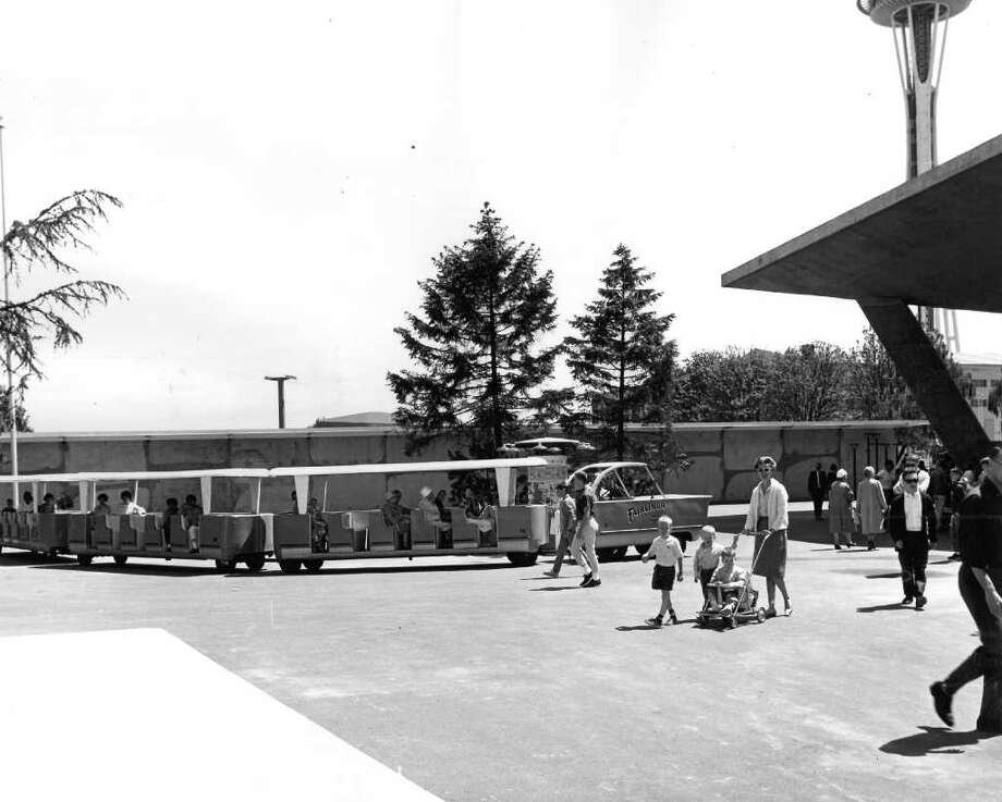 People tour the Seattle Center grounds June 3,