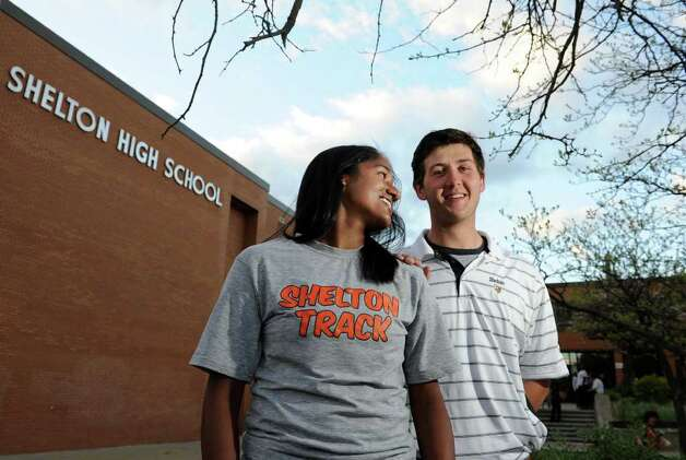 Shelton seniors Sonali Rodrigues and James Tate stand outside Shelton High School Tuesday, May 10, 2011.   Tate asked Rodrigues to the prom by posting a message on the wall behind them.  She said yes but he is now prohibited from attending the school's prom as punishment for trespassing to post the sign. Photo: Autumn Driscoll / Connecticut Post