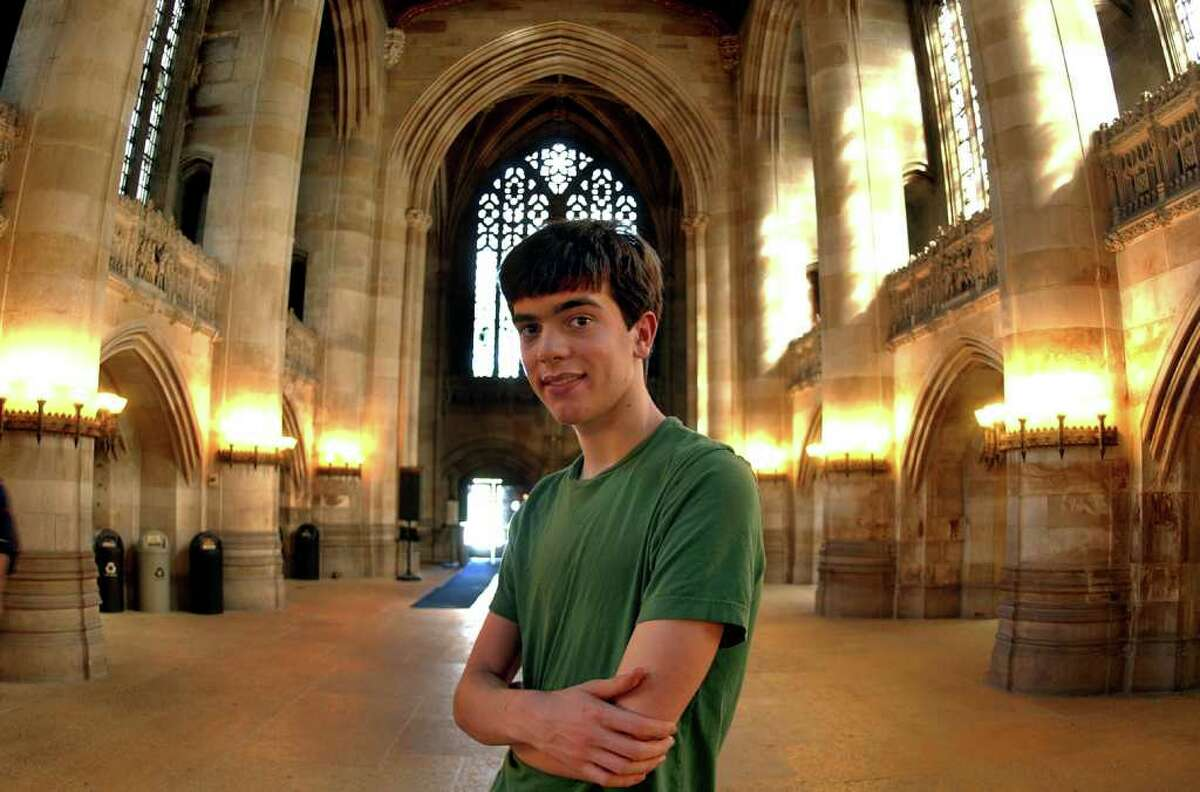 Will Sawin, of Fairfield, poses inside the library on the campus of Yale in New Haven, Conn. on Tuesday May 10, 2011. Sawin, 17, will graduate from Yale with a degree in math and then graduate from high school at Fairfield Warde.