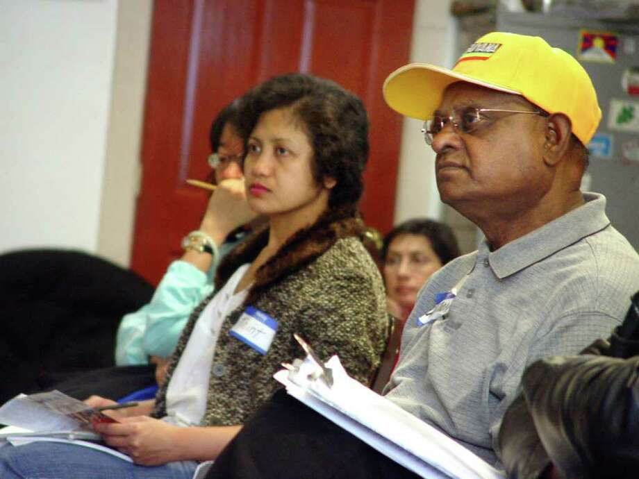 Among the 21 students taking medical interpreter training in Albany are Thint Thint Htoo of Rensselaer, right, who speaks Burmese, and Schenectady resident Bharath Arjoon, left, who is fluent in Guyanese. (Courtesy St. Peter?s Hospital)