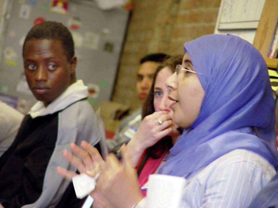 Fadwa Touati of Rennselaer, right, who is fluent in Arabic and French, speaks out during medical interpreter training conducted by MAMI Interpreters. (Courtesy St. Peter?s Hospital)