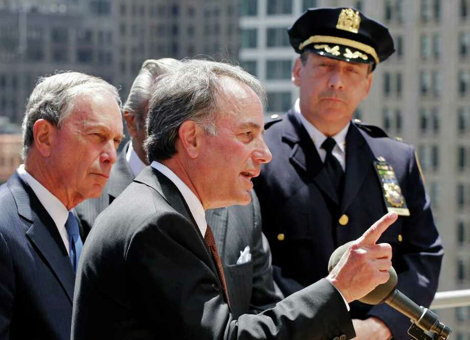 Ivan Seidenberg, center, the CEO of Verizon, talks at a news conference overlooking the World Trade Center site, Tuesday, May 10, 2011 in New York. New York Mayor Michael Bloomberg, left, and representatives from the FCC, FEMA, and wireless providers announced that New York City will launch an emergency alert system by the end of the year that will send messages to specially enabled cell phones during disasters. At right is Deputy Chief Charles Dowd with the New York Police Department's Communications Division. (AP Photo/Mark Lennihan) Photo: Mark Lennihan