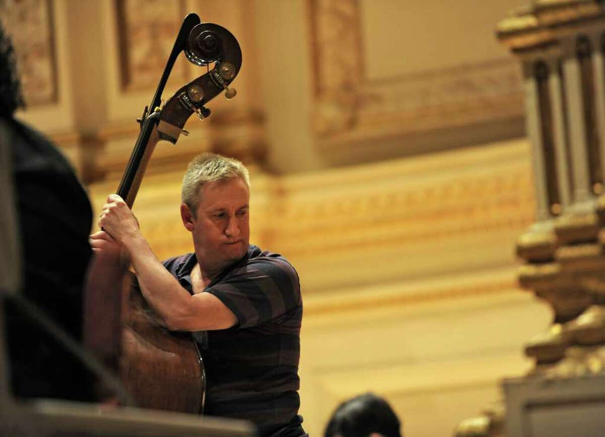 A musician with the Albany Symphony Orchestra takes a rest during rehearsal before the ASO's debut concert at Carnegie Hall in NEW YORK Tuesday May 10, 2011. (Lori Van Buren / Times Union)