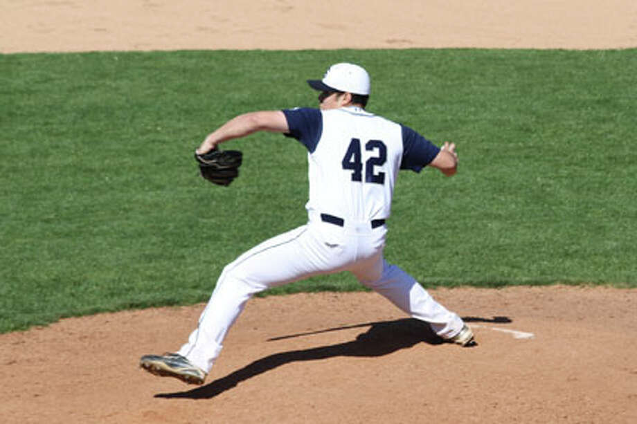 Staples sophomore Bryan Terzian throws heat Monday in an 8-7 home loss to Stamford. Photo: Contributed Photo