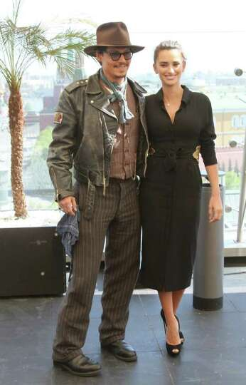 US actors Johnny Depp and Penelope Cruz pose at the Ritz Hotel roof in Moscow, Russia, Wednesday, Ma