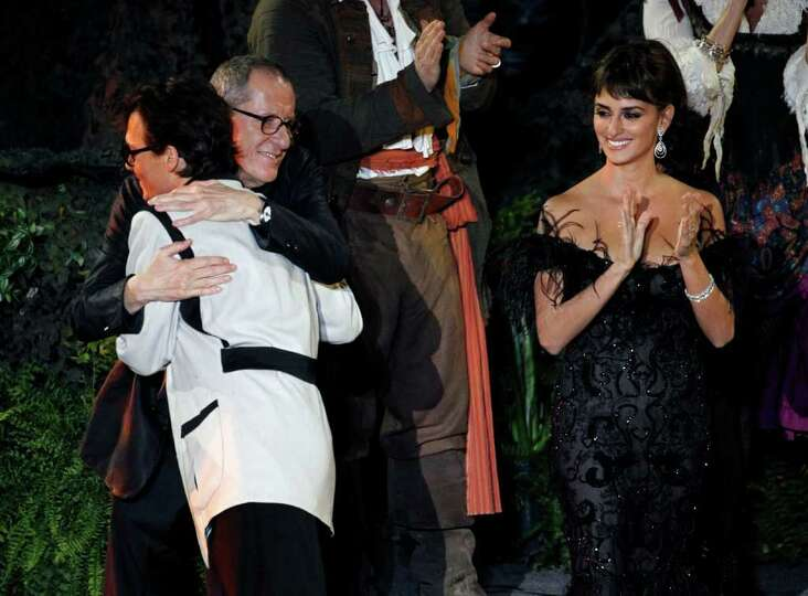 From left, Johnny Depp, Geoffrey Rush, and Penélope Cruz arrive at the World Premiere of