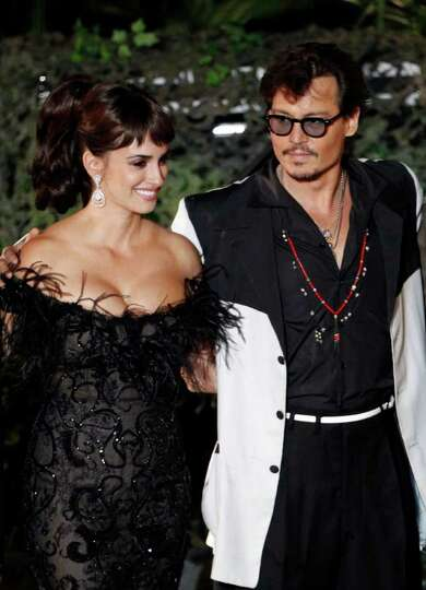 Penélope Cruz, left, and Johnny Depp arrive at the World Premiere of