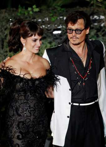 "Penélope Cruz, left, and Johnny Depp arrive at the World Premiere of ""Pirates of the Caribbean: On Stranger Tides"" at Disneyland in Anaheim, Calif., on Saturday, May 7, 2011. Photo: AP"