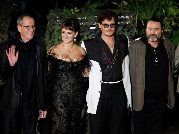 From left, Geoffrey Rush, Penélope Cruz, Johnny Depp, and Ian McShane arrive at the World Premiere