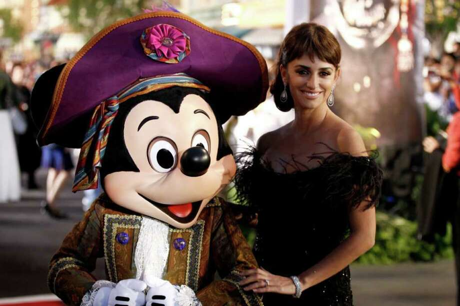 "Penélope Cruz and Mickey Mouse are seen at the World Premiere of ""Pirates of the Caribbean: On Stranger Tides"" at Disneyland in Anaheim, Calif., on Saturday, May 7, 2011. Photo: AP"