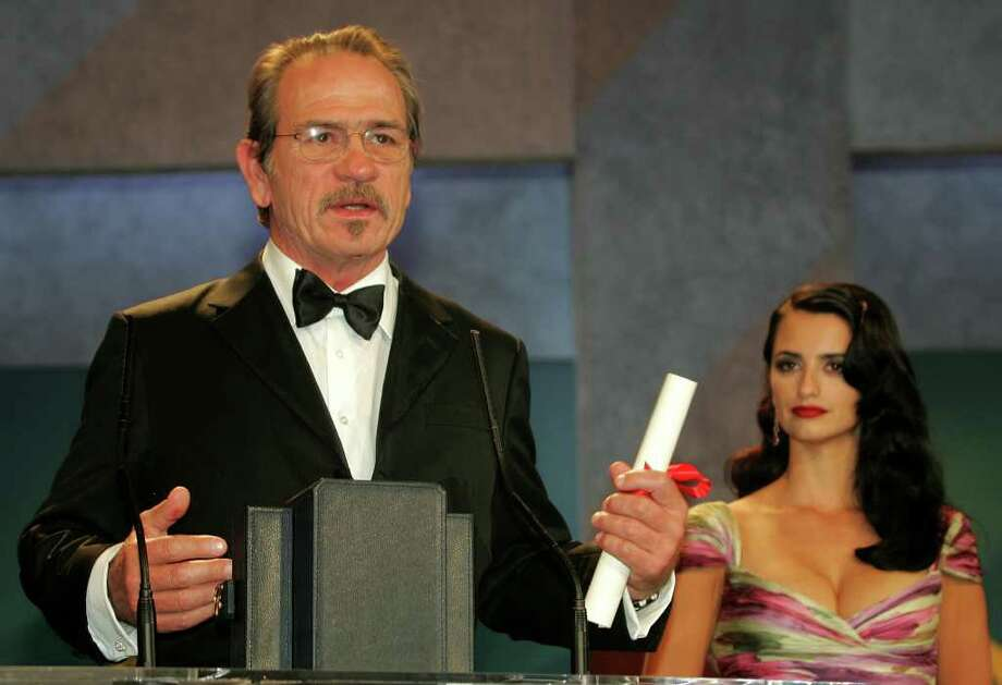 "American actor Tommy Lee Jones speaks after he won the Best Actor award for his role in ""The Three Burials of Melquiades Estrada"" which he also directed himself, at the 58th international Cannes film festival, southern France, on the French Riviera, Satuday, May 21, 2005. Spanish actress Penelope Cruz is on the right. Photo: LIONEL CIRONNEAU, AP / AP"