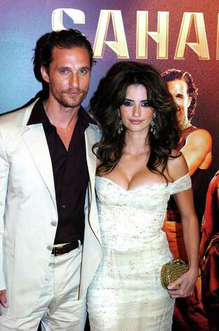 Spanish actress Penelope Cruz, right, and U.S. actor Matthew McConaughey pose before the Spanish premiere of their latest movie Sahara in Madrid, Wednesday, April 13, 2005. (AP Photo/Alberto Martin) ** LATIN AMERICA, CARIBBEAN AND SPAIN OUT ** Photo: ALBERTO MARTIN, AP / EFE