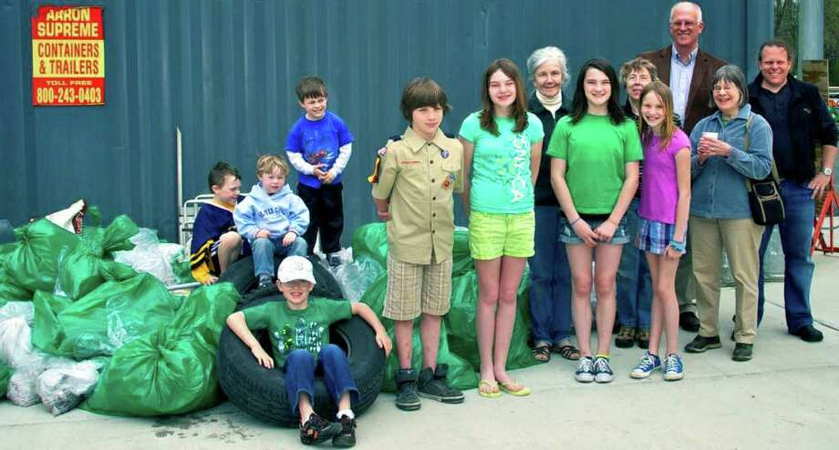 SPECTRUM/Among those to lend their efforts to last week's Kent clean up were First Selectman Bruce Adams, Liddy Baker and Wendy Murphy  of the Kent Consevation Commission, Anne Everett, Girl Scouts Lily Bournival, 12, and Abigail Johnson, 11, Boy Scout Eli Jonson, 9, Finn Bournival, 7, Emma Bournival, 10, Jules Manes, 8, Fuller Manes, 2, Woody Manes, 5, and their father, Adam Manes. Photo: Trish Haldin / Trish Haldin