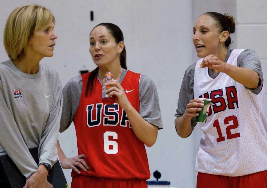 Diana Taurasi, right, and Sue Bird, center, talk with coach Chris Dailey during the U.S. women's national basketball team practice, Tuesday, May 10, 2011, in Las Vegas. Photo: Julie Jacobson