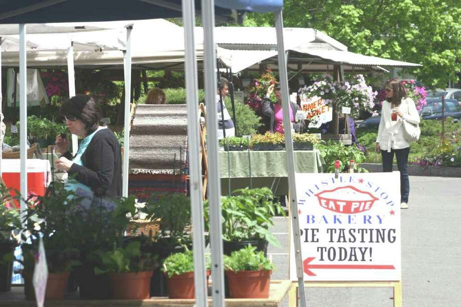 The Darien Farmer's Market drew people from all over the state who sold a variety of items from flowers and vegetables to cheese and soap products. Photo: Contributed Photo / Darien News
