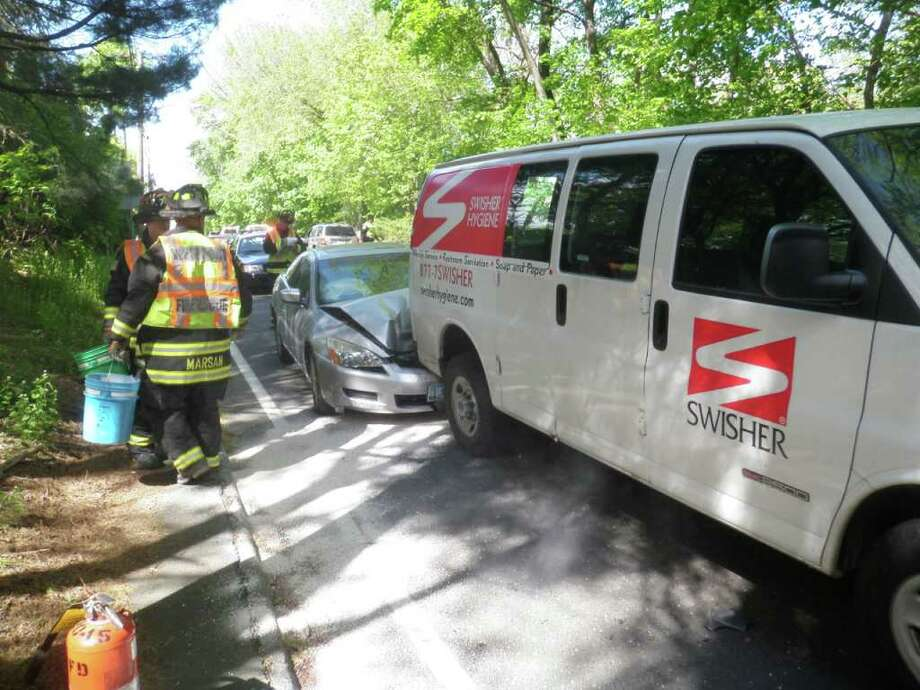 Three vehicles were involved in an accident at the intersection of Main Street and Clinton Avenue at approximately 3:30 p.m. on Wednesday, May 11, 2011. Photo: Contributed Photo / Westport News contributed