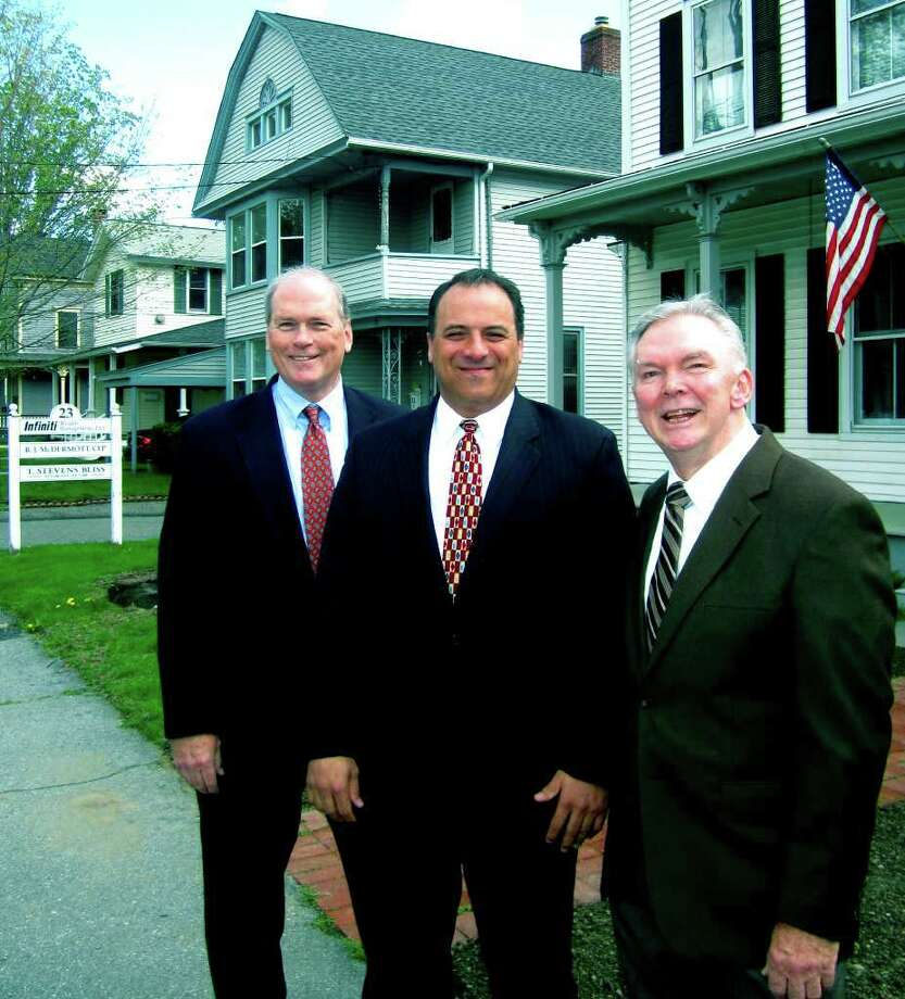 SPECTRUM/George Waters, left, and Michael Durante are teaming with founder and now associate partner Bob McDermott, right, at Infiniti Wealth Management on South Main Street in New Milford. Photo: Norm Cummings / The News-Times