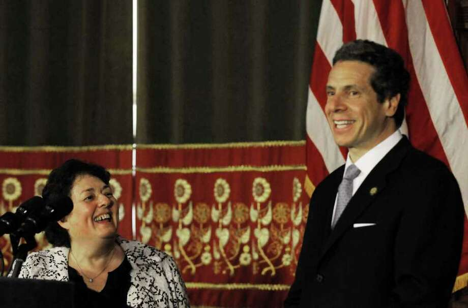 Governor Andrew M. Cuomo,right, introduces Assemblywoman RoAnn Destito as Commissioner of the New York State Office of General Services at the Capitol in Albany, NY Wednesday April 11,2011.( Michael P. Farrell/Times Union ) Photo: Michael P. Farrell