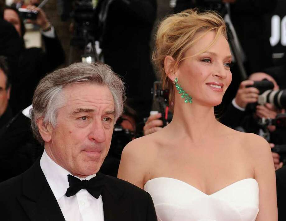 Jury President Robert De Niro (L) and Jury Member Uma Thurman attend the Opening Ceremony at the Palais des Festivals during the 64th Cannes Film Festival on May 11, 2011 in Cannes, France.  (Photo by Ian Gavan/Getty Images) *** Local Caption *** Robert De Niro;Uma Thurman; Photo: Getty Images