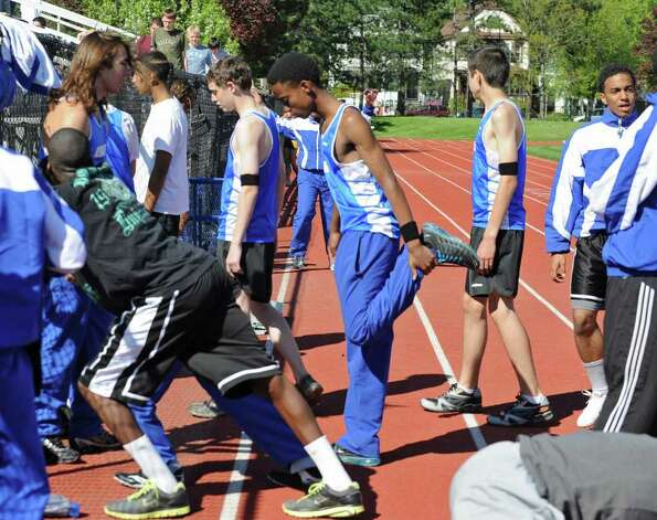 The Albany High track holds its first home meet since the death of Tyler Rhodes in Albany, N.Y. on Monday May 9, 2011. The team wore black arm bands in his memory. (Lori Van Buren / Times Union) Photo: Lori Van Buren