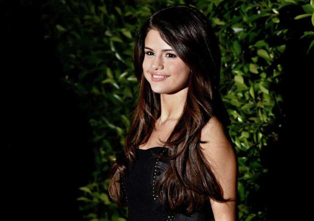 "Selena Gomez arrives at an Evening of ""Southern Style"" presented by The St. Bernard Project and the Spears Family in Beverly Hills, Calif., Wednesday, May 11, 2011.  The St. Bernard Project is a non-profit organization that  provides relief work for survivors of Hurricane Katrina. Photo: AP"