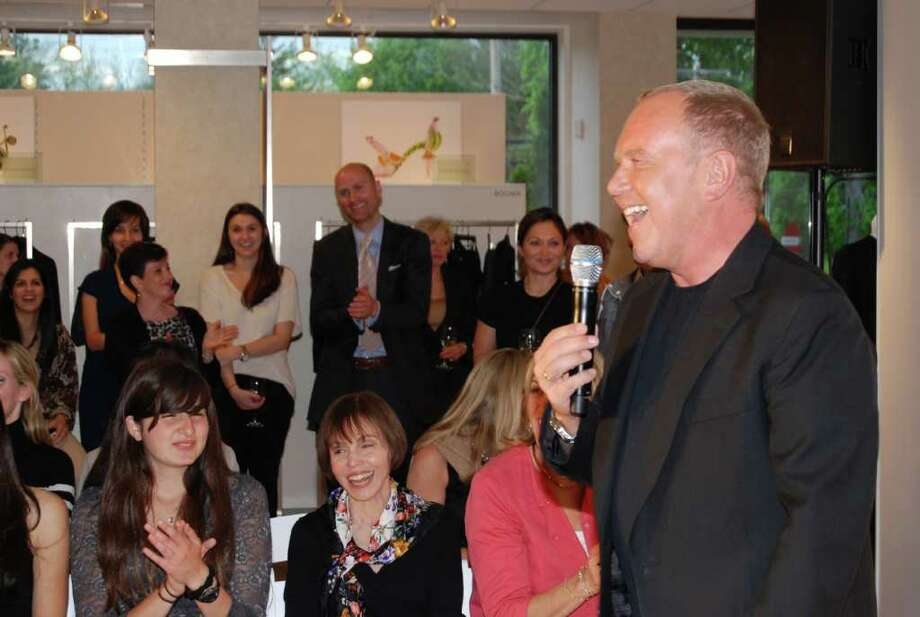 Michael Kors charmed a chic crowd at Mitchell's of Westport on Tuesday evening, May 10, 2011.  After greeting the Fairfield County audience, he presented his dazzling Fall 2011 Womenswear Collection on the runway. Photo: Jeanna Petersen Shepard / New Canaan News
