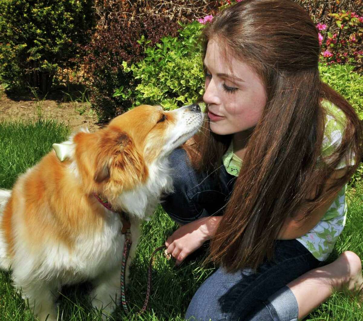 Allison Accettella, 15, a high school student recovering from Lyme disease, with her dog