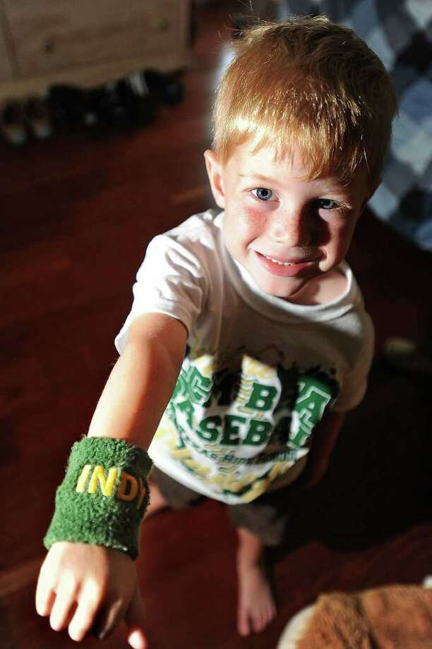 Although diagnosed with diffused infiltrated pontine glioma and told to have a diminutive life expectancy, Indy Parkhurst's spirit has earned him the title of unofficial mascot for LC-M's baseball team. In support, players have begun wearing green and gold wristbands, shown, labeled 'Indy'.  Guiseppe Barranco/The Enterprise Photo: Guiseppe Barranco