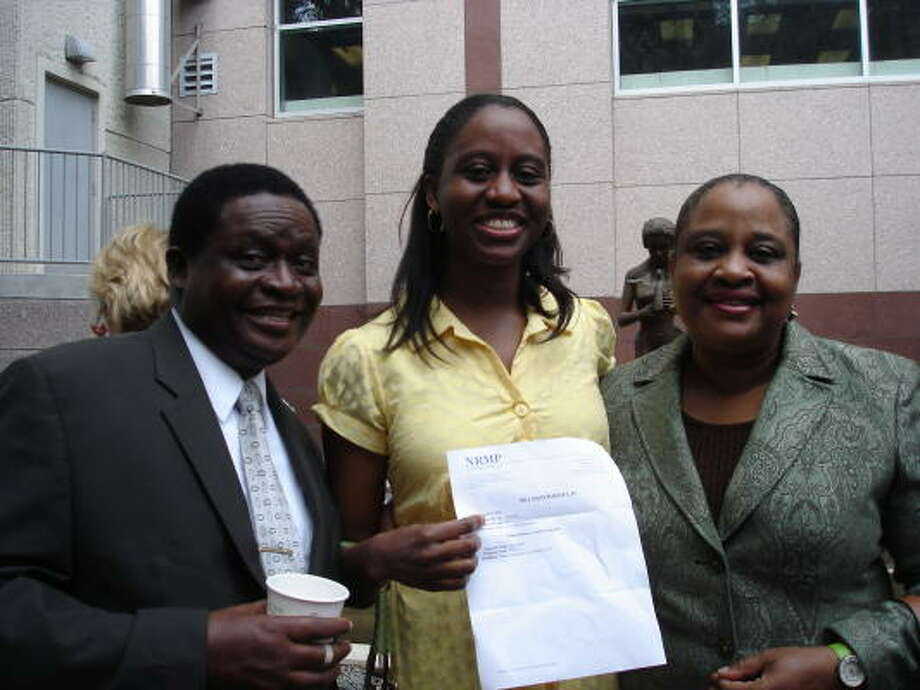 COURTESY PHOTO HAPPY DAY: Omosede Evbuomwan and her parents: Photo: ALL